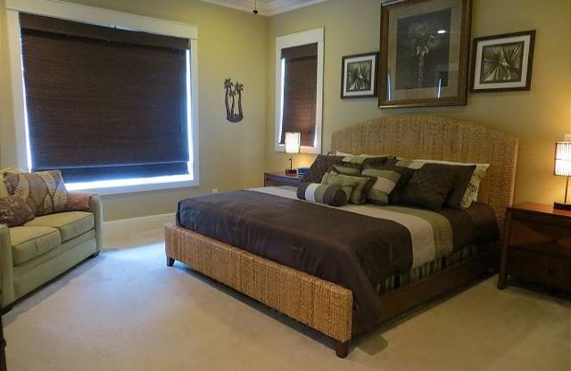 Rental bedroom at Aqua Vacations and Sales Group.