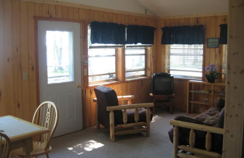 Cabin living room at Finn'n Feather Resort.