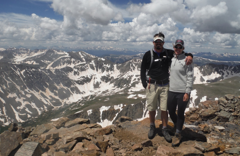 Couple on mountain top at Tumbling River Ranch.