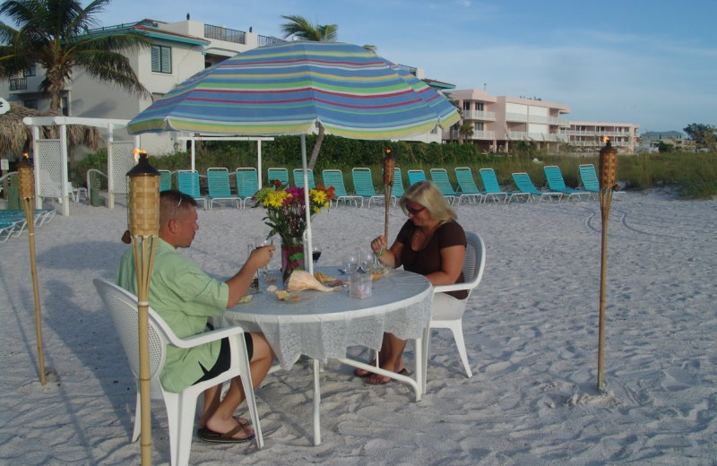 Dining on the beach at Cedar Cove Resort & Cottages.