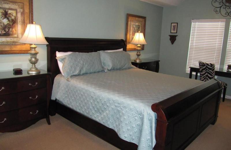 Vacation rental bedroom at Newman-Dailey Resort Properties, Inc.