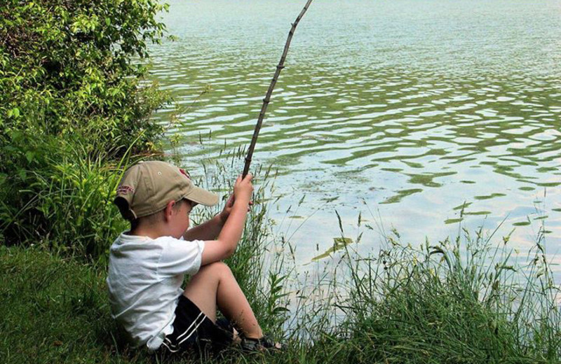 Kid fishing at Wilderness Resort Villas.