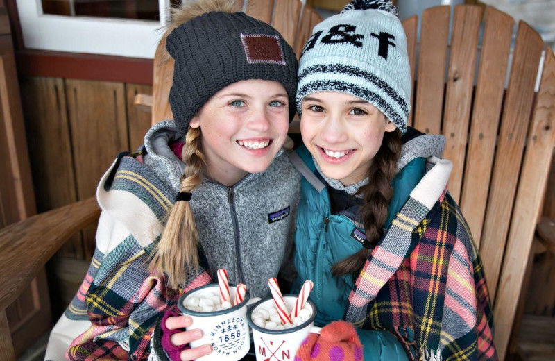 Kids with cocoa at Lutsen Resort on Lake Superior.