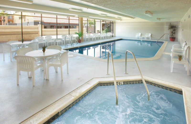 Indoor pool and hot tub at The Anaheim Desert Inn & Suites.