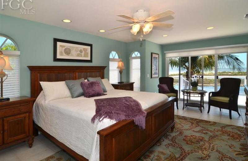 Vacation rental bedroom at Sun Palace Vacations.