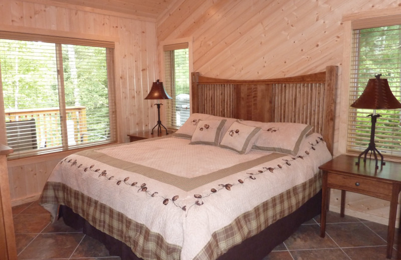Cabin bedroom at River Point Resort & Outfitting Co.