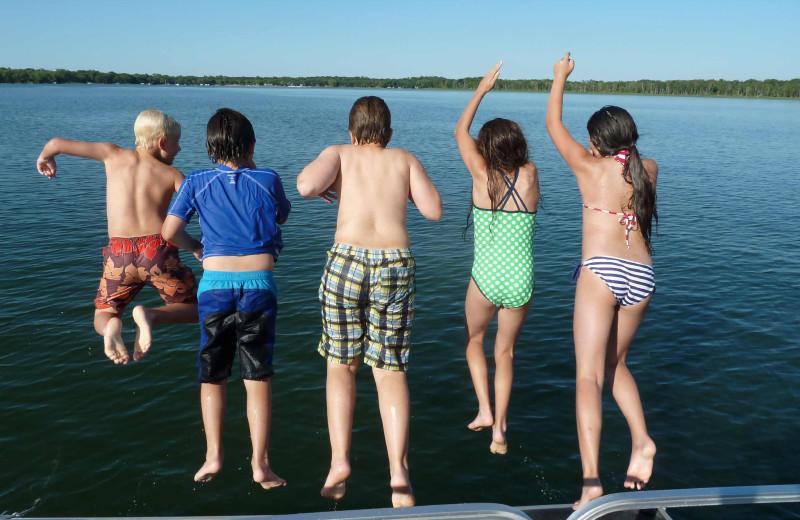 Kids jumping in lake at Woodlawn Resort.
