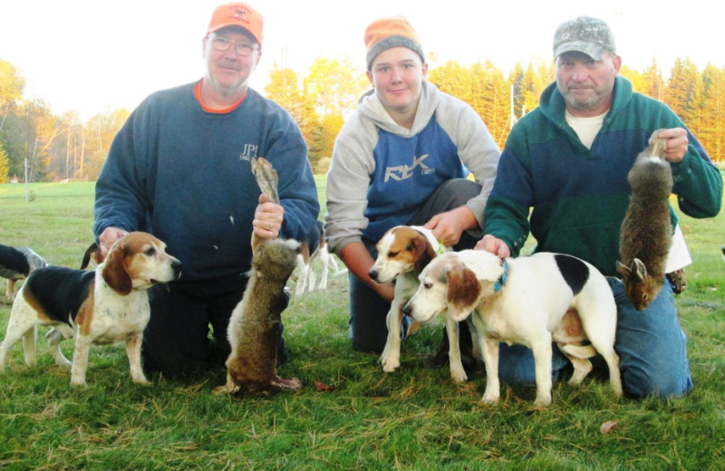Rabbit hunters, their prized dogs, and grateful harvest of snowshoe hares in Essex County, Canaan, Vermont's Northeast Kingdom.