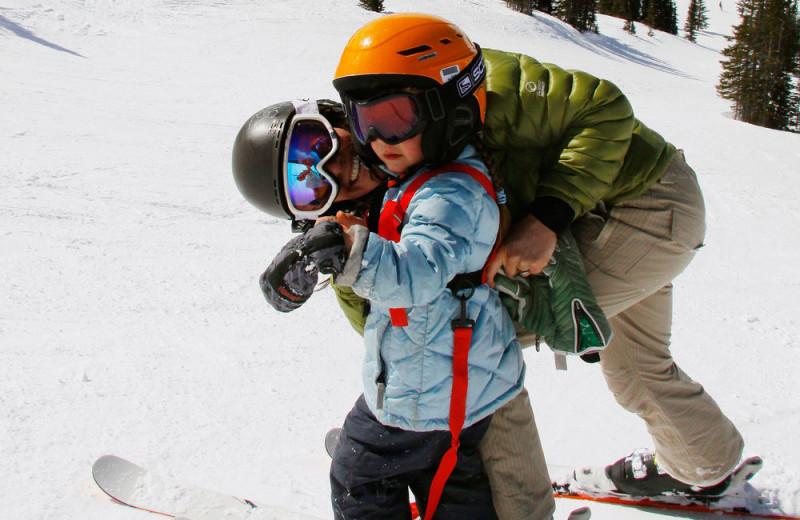 Family skiing at Gingerbread Cabin.