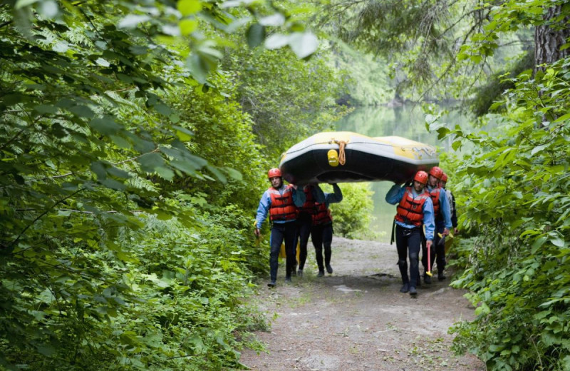 Group carrying raft at REO Rafting Resort.