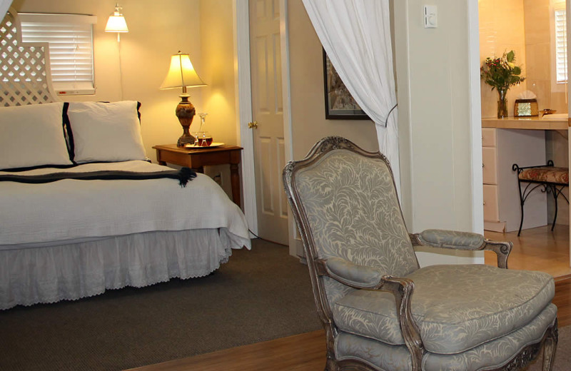 Guest room at Lamp Lighter Inn & Sunset House Suites.
