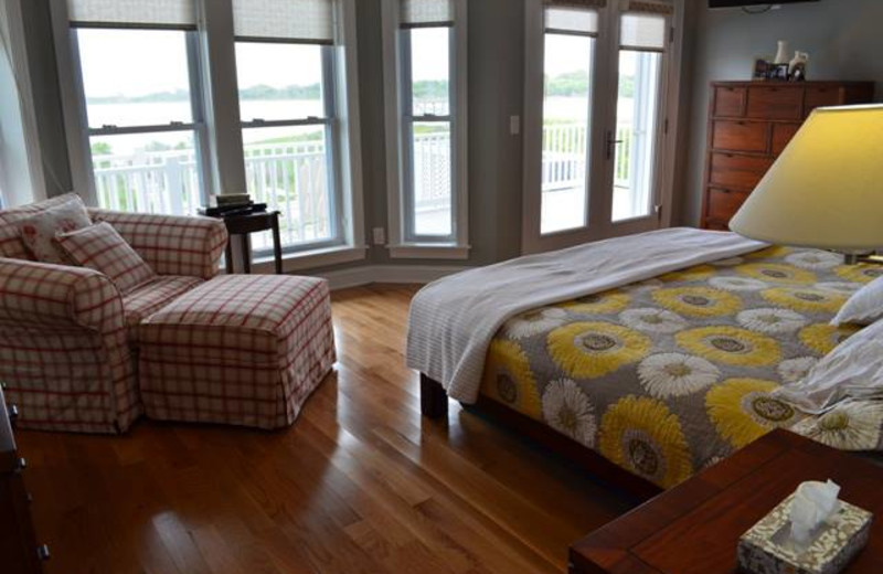 Vacation rental bedroom at Century 21 Action Inc.