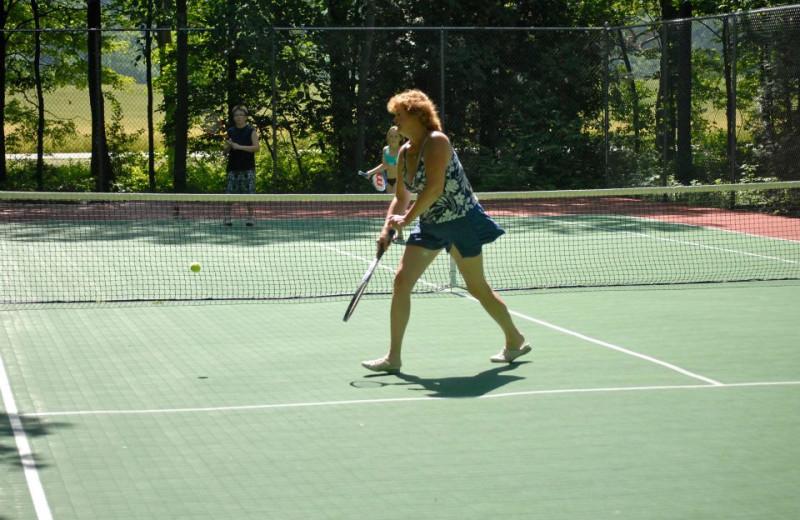 Playing tennis at The Shallows Resort.