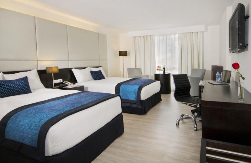 Guest room at Hotel Oro Verde Cuenca.