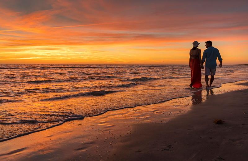 Couple on beach at TradeWinds Island Grand.