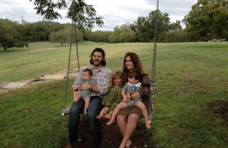 Family on swing at Haven River Inn.