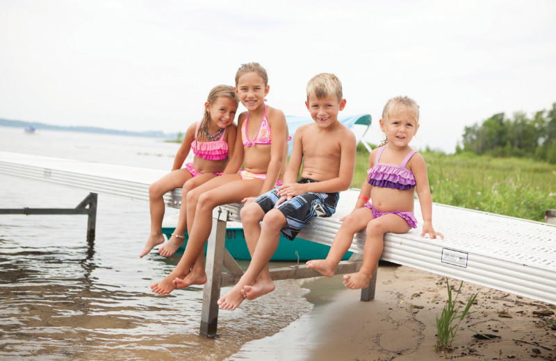 Family on beach at Grand Traverse Resort and Spa.
