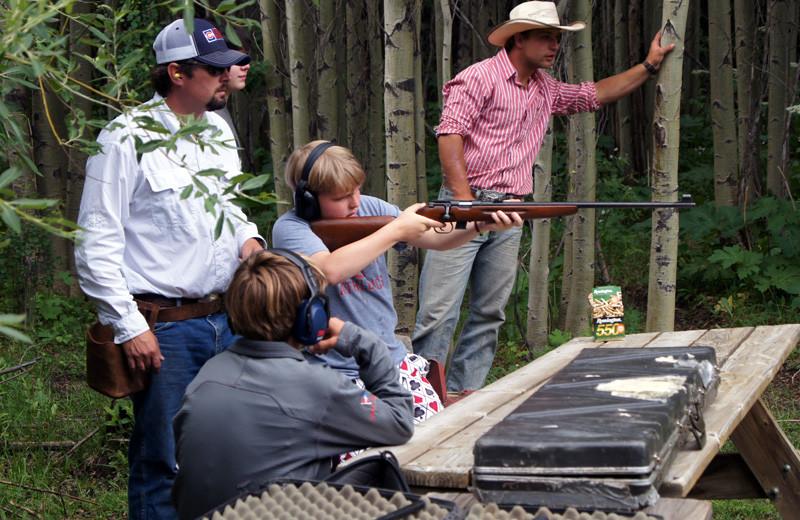 Trap shooting at Tumbling River Ranch.