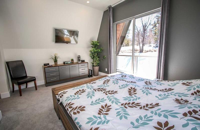 Rental bedroom at Big Bear Vacations.