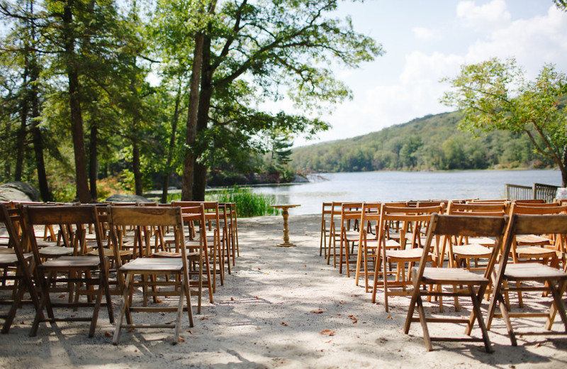 Lakeside wedding ceremony at Arrow Park Lake and Lodge.