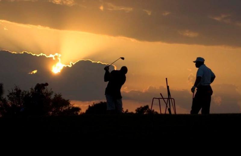 Golfing at Beau Rivage Resort.