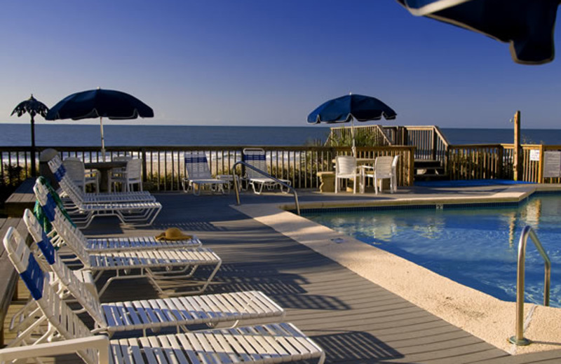 Lounge chairs by pool at Ocean Isle Inn.