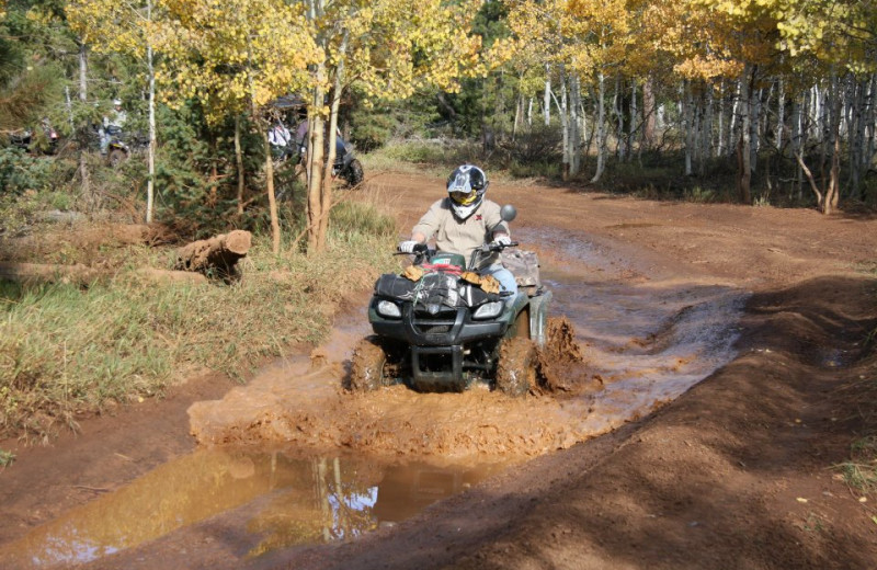 Riding ATV at Pinewoods Resort.
