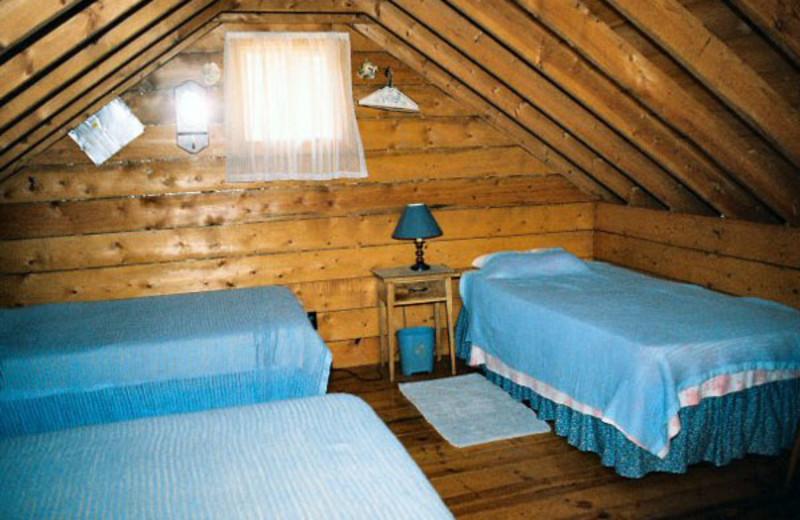 Cabin bedroom at Argyle Lake Lodge.