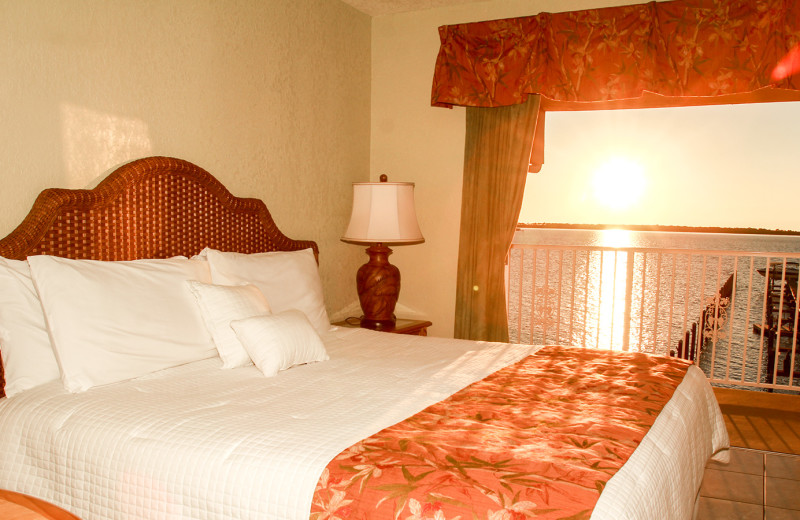Guest bed at Beso Del Sol Resort.