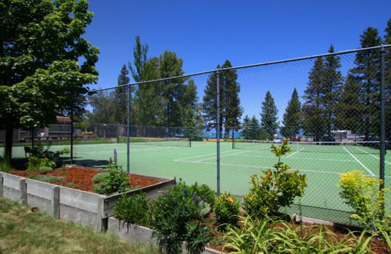 Tennis courts at Aston Lakeland Village.