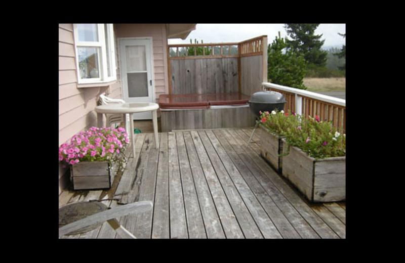 Rental deck with hot tub at Manzanita Rental Company.