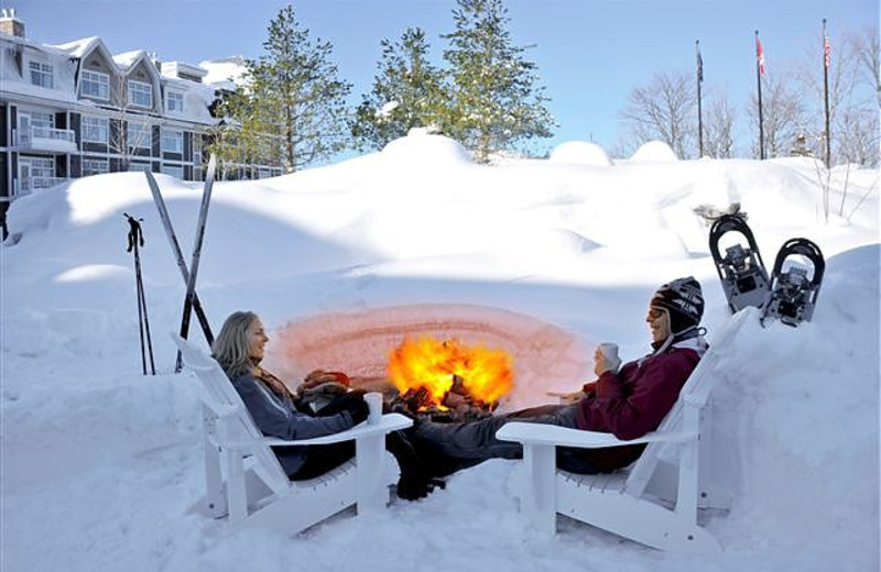Relax by the bonfire at JW Marriott The Rosseau Muskoka Resort & Spa.