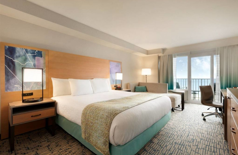 Guest room at Surfbreak Oceanfront Hotel.