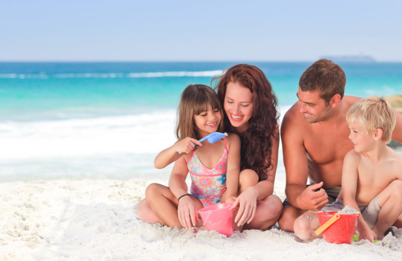 Family on beach at Together Resorts.