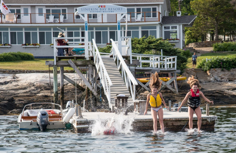 Jumping in water at Linekin Bay Resort.