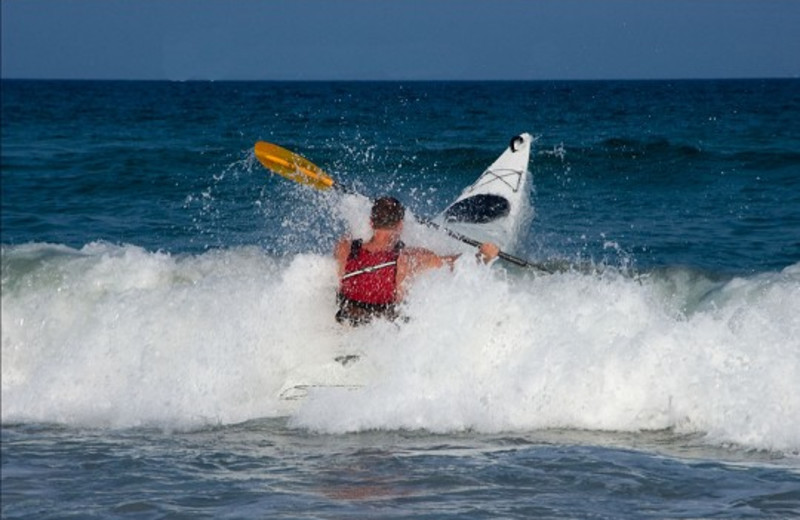 Playing in the ocean at Ocean Isle Inn.