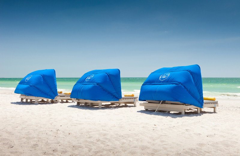 Lounging on the beach at TradeWinds Island Grand.
