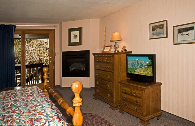Guest room with fireplace at 4 Seasons Inn.