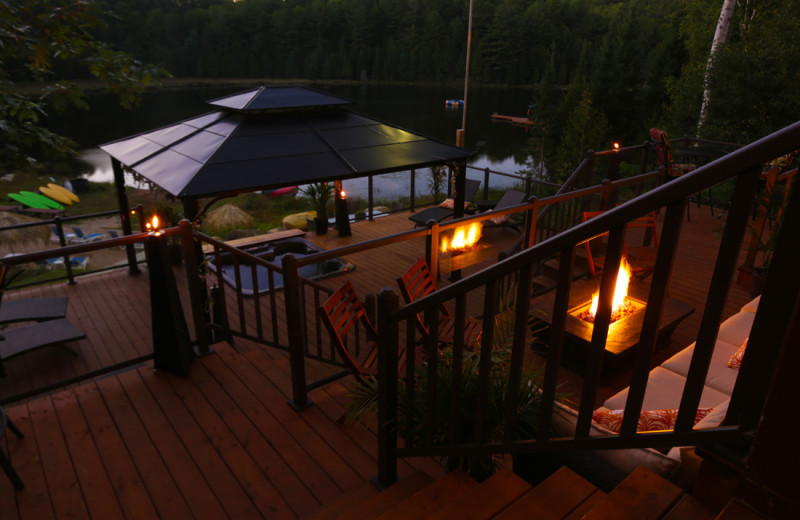 A view of the patio, hot tub and lake. So romantic at night!