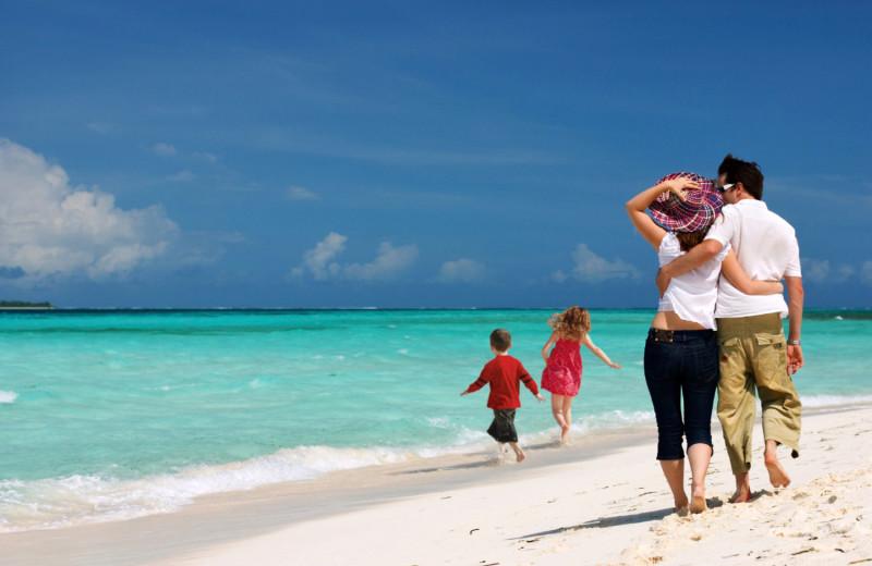 Family on beach at Sanibel Vacations.