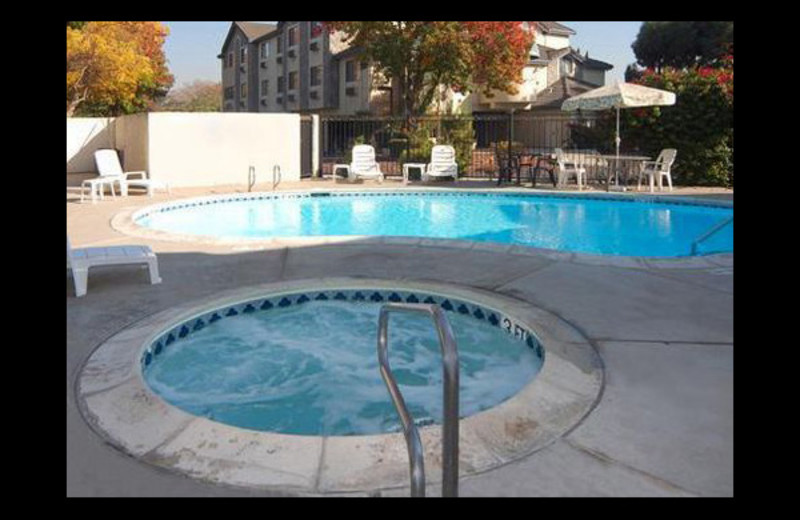 Outdoor pool and hot tub at Clarion Hotel.