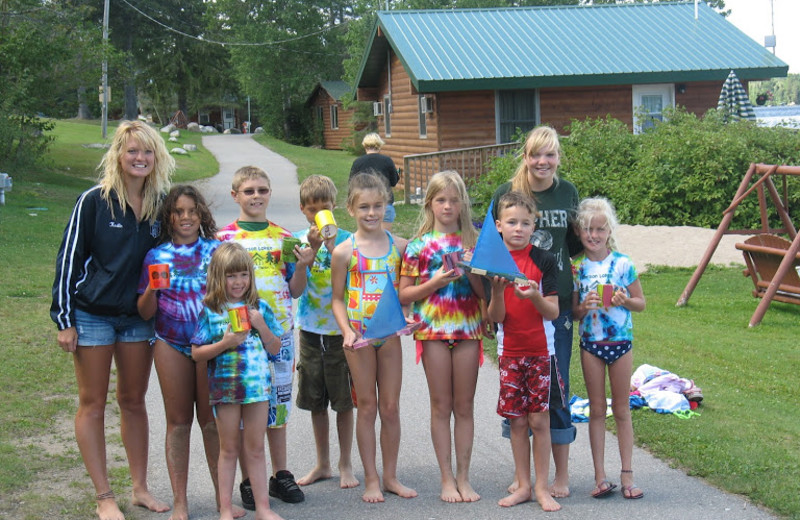 Camp Twain group wearing their tie dye shirts that they made during the week.