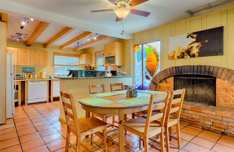 Cottage kitchen and dining room atSeabreeze Vacation Rentals, LLC.