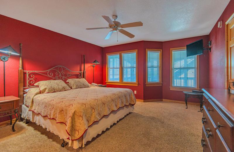Rental bedroom at Joe Lamb Jr. & Associates Vacation Rentals.