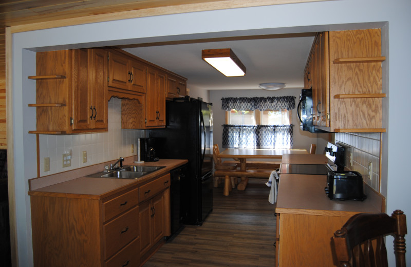 Cabin kitchen at Sandy Pines Resort.