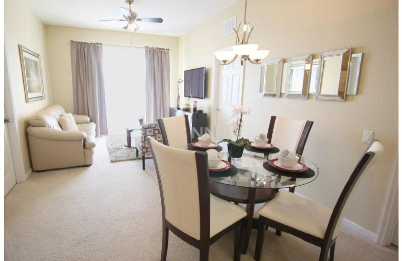 Rental dining and living room at Favorite Vacation Homes.