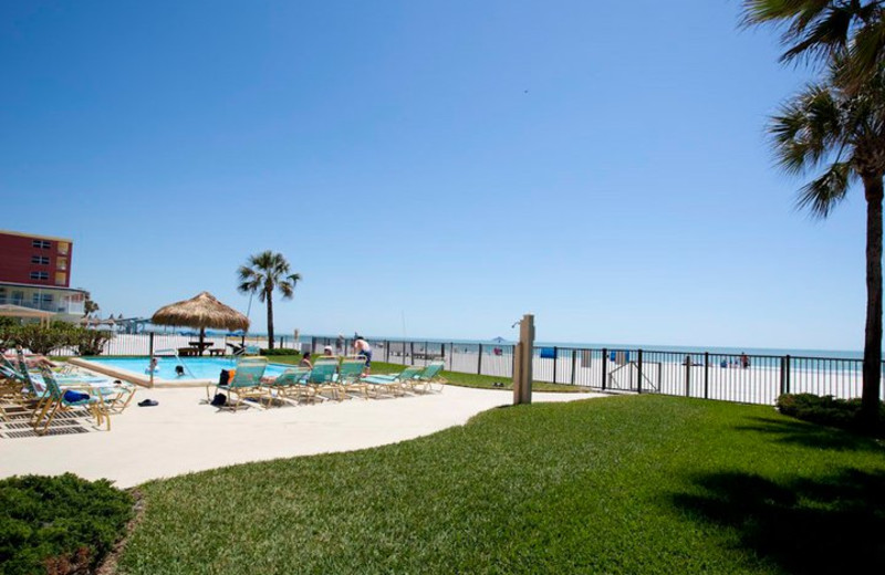 Outdoor pool and beach at Resort Rentals.