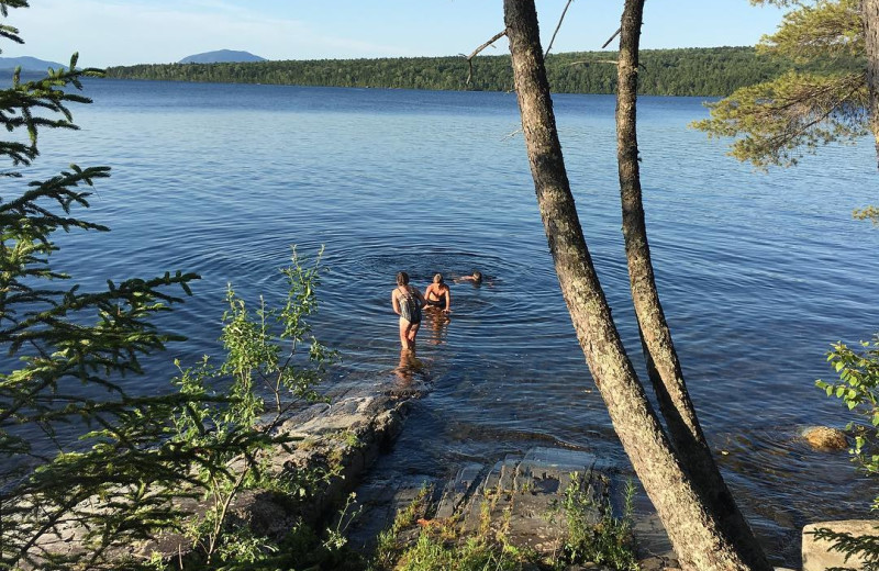 Swimming in lake at Wilsons on Moosehead Lake.