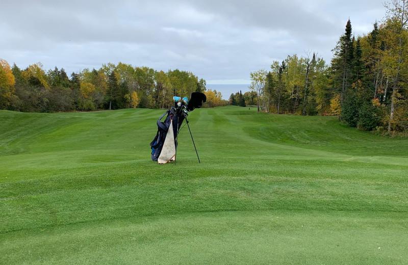 Golf course at Thomsonite Beach Inn & Suites.