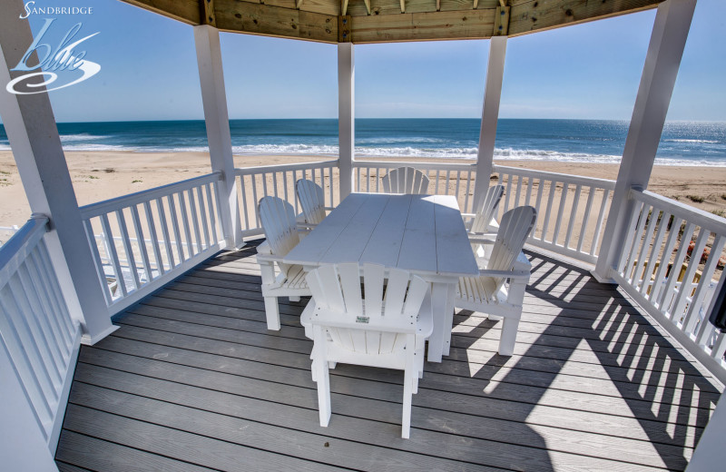 Rental deck at Sandbridge Blue Vacation Rentals.
